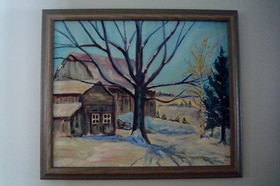 Painting of two barns in winter
