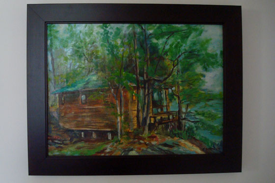 Painting of a green cottage among trees