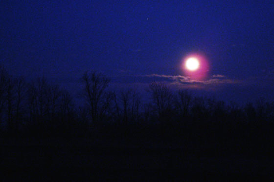 Full moon over country fields