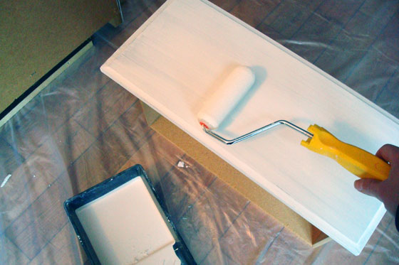 Painting a dresser with a foam roller