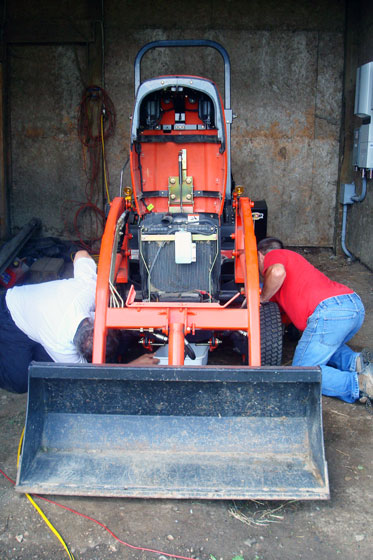 Changing the oiil on our tractor