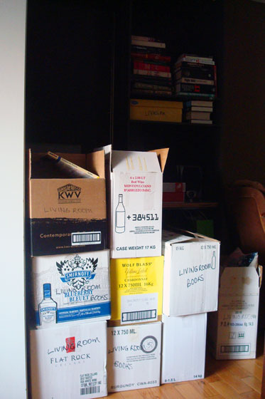 Bookshelves and boxes of books