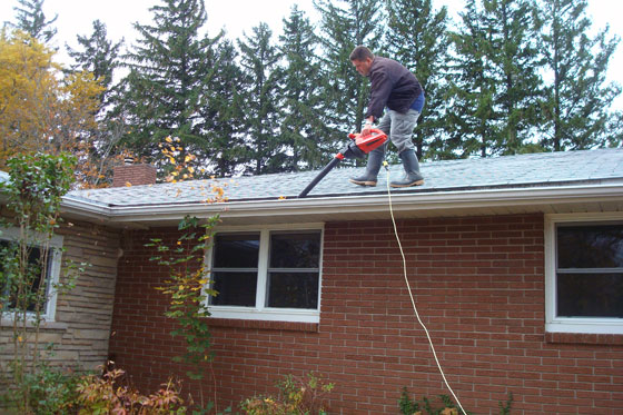 Cleaning gutters with a leaf blower