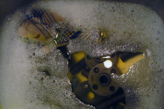 Washing the oil off of pipe fittings