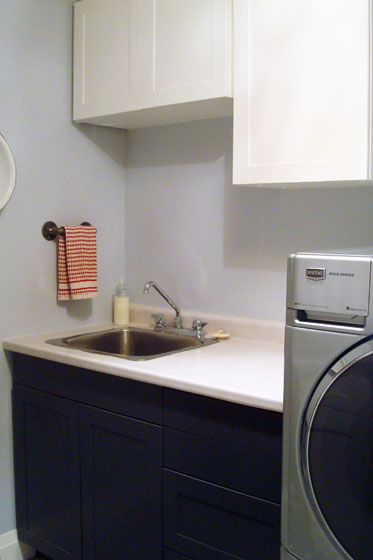 Black and white shaker cabinets in the laundry room