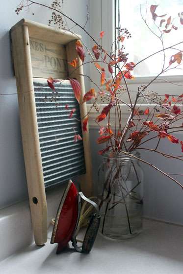 Vintage washboard and red toy iron in the laundry room