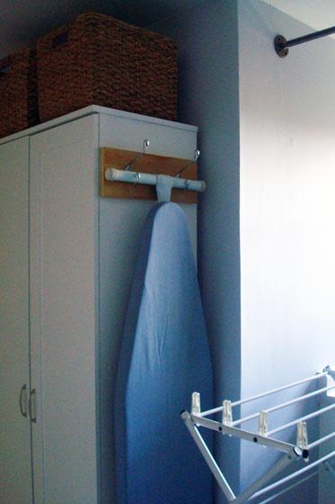 Ironing board hanger