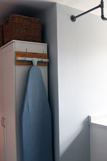 Hanging ironing board in the laundry room