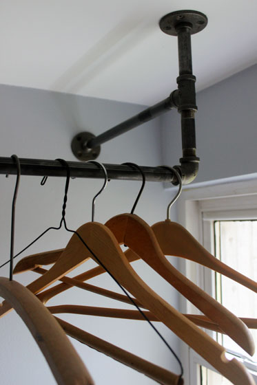 Vintage wood hanngers on a hanging rack