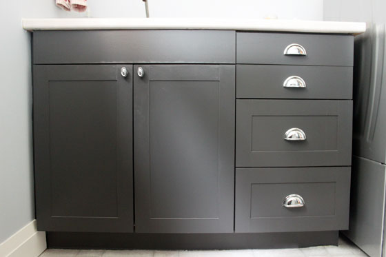 Black shaker cabinets with chrome cup pulls and knobs