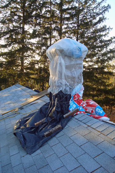 Chimney wrapped in plastic