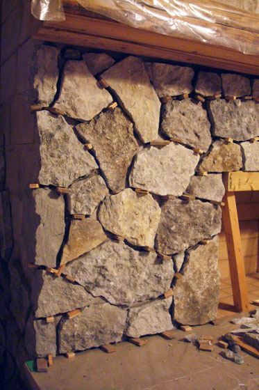 Fieldstone veneer on a fireplace