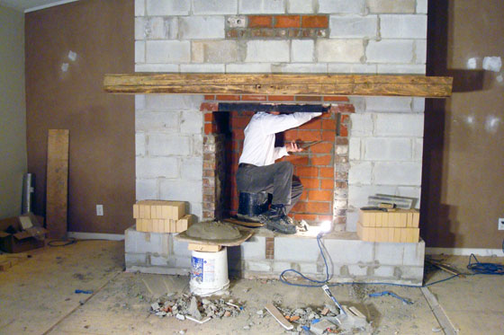 Mason building a fireplace