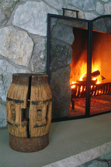Old wagon wheel hub on a stone fireplace hearth