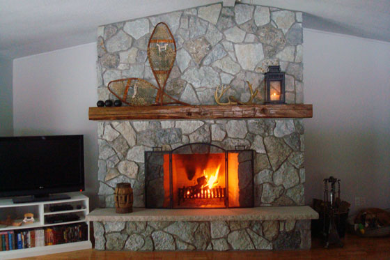 Fieldstone fireplace with barn beam mantel