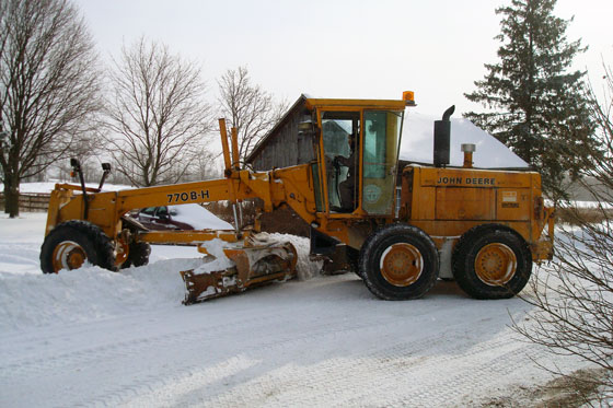 Grader plowing the driveway