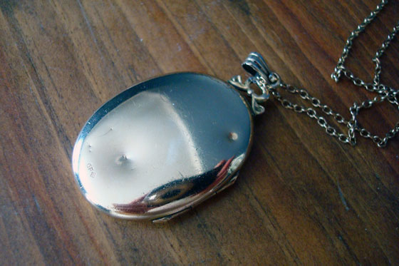 Dented antique gold locket
