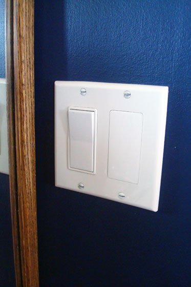 Blank plate covering a light switch