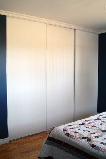 Beadboard wallpaper on sliding closet doors