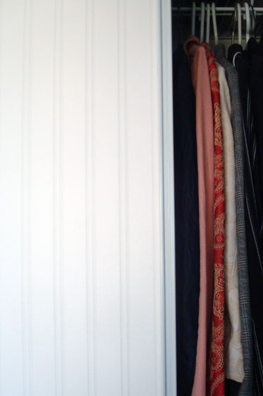 Beadboard wallpaper on a sliding closet door