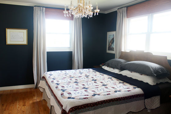 Dropcloth curtains in a navy master bedroom