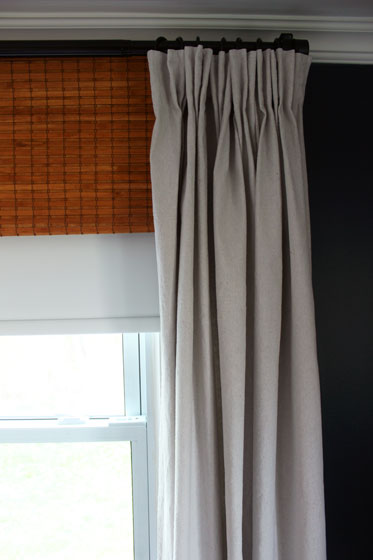 Blackout blind, bamboo blind and drop cloth curtain window treatments