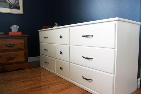 White dresser with aged brass hardware