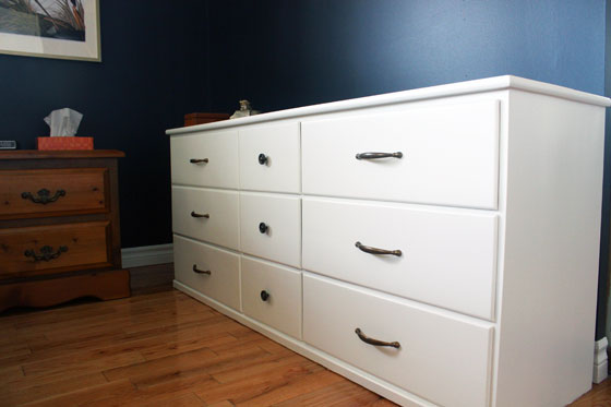 White dresser with aged brass hardware