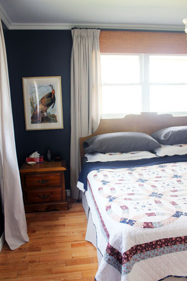 Navy, wood and white master bedroom