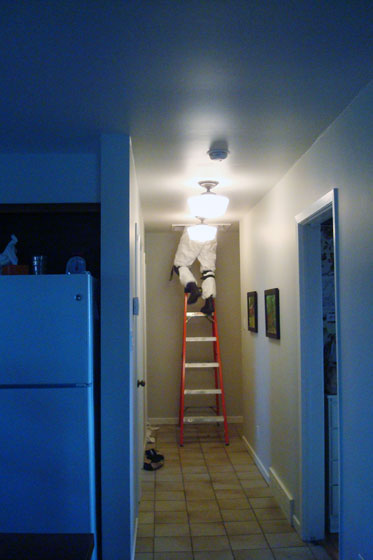 Electrician going into the attic