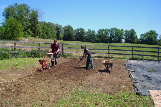 Matt and I tilling the garden