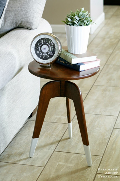 Modern three-legged end table by Pneumatic Addict