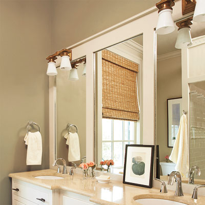 Dress up a plain mirror that's adhered to the wall by overlaying a wood frame