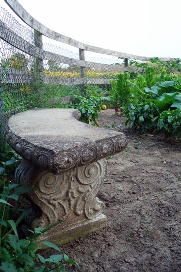Stone bench in the vegetable garden