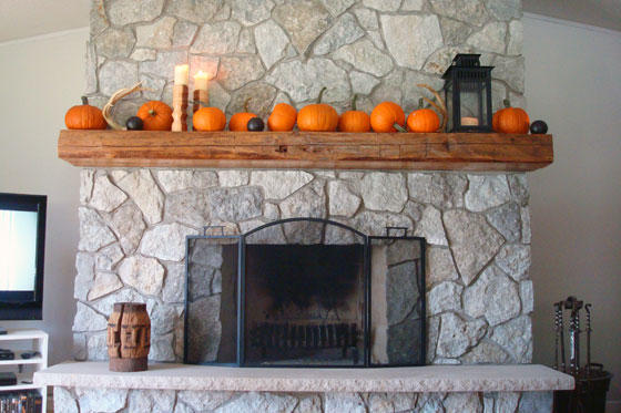 Stone fireplace decorated for fall with pumpkins