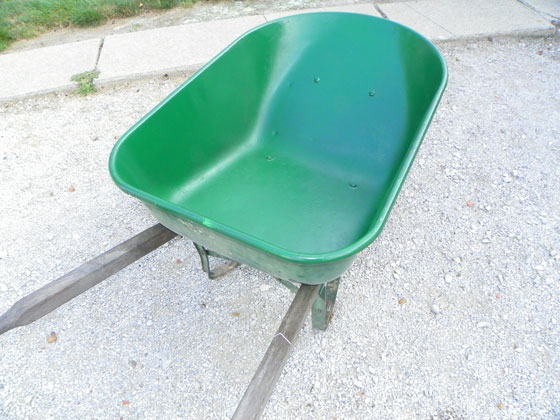 Green painted wheelbarrow