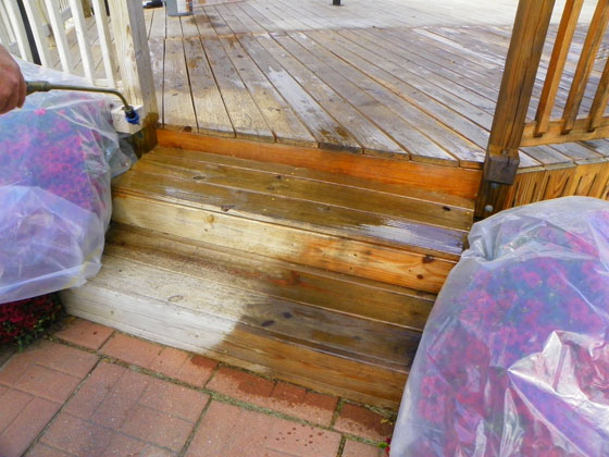 Applying sealer to the deck