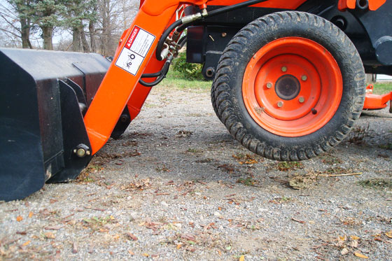 Use the front end loader to lift the front wheels off the ground