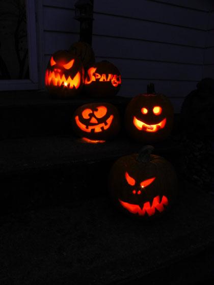 Jack o'lanterns lit up at night