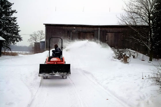 Clearing snow with the tractor