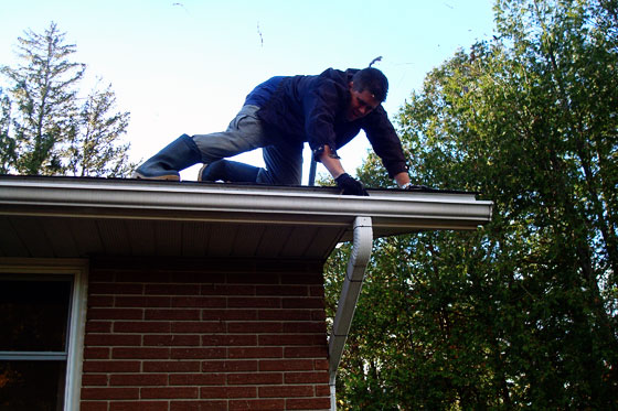 Matt cleaning the gutters