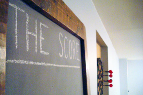 Tall chalkboard for score-keeping in the games room
