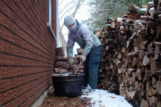 Loading firewood into the washtub