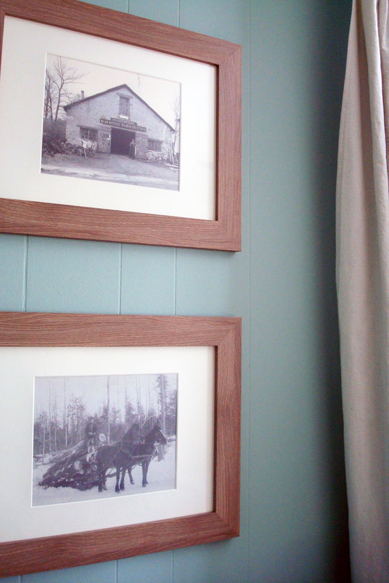 Vintage family photos displayed in the guest room