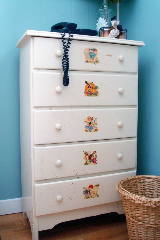 Vintage dresser with nursery rhyme illustrations