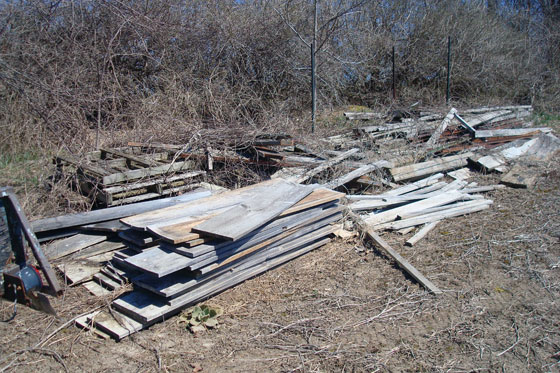 Lumber pile at the edge of the field