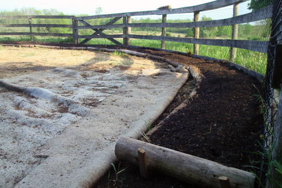 Rustic raised beds in a round vegetable garden