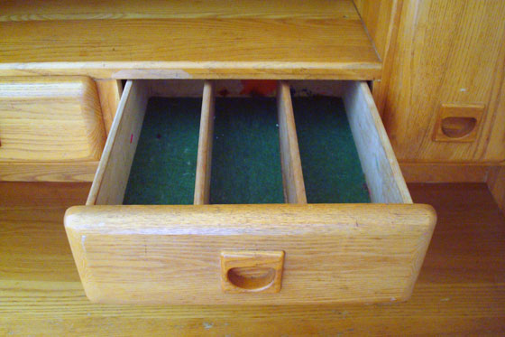 Silverware drawer in the vintage china cabinet