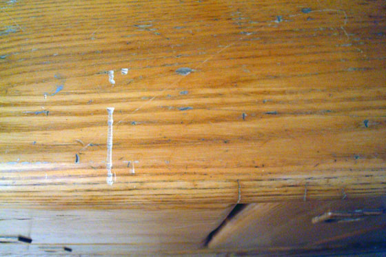 Scratches in the wood top of the china cabinet