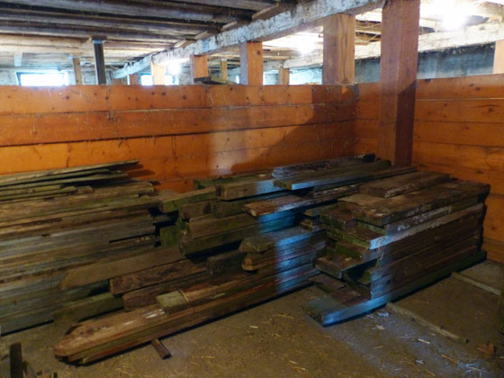 Lumber piled in a horse stall